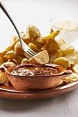 Patatas bravas (fried potatoes with tomato sauce, Spain)