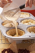 Tartlets being made in a muffin tin