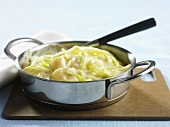 Jerusalem artichokes with onions in a cream sauce