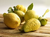 An arrangement of lemons on a wooden table