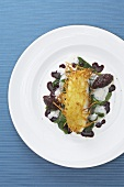 Turbot with a potato crust, spinach and red onion chutney