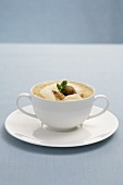 Artichoke soup with Gruyere foam