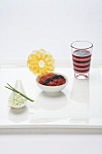 Beef tartar with mustard rice, layered beetroot and crisps