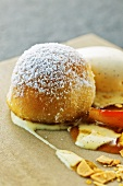 Walnut buchteln (baked, sweet yeast dumpling) with vanilla ice cream