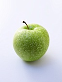 A freshly washed Granny Smith apple