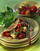Pancake filled with avocado and tomato salad