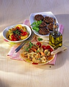 Vegetable skewers, potato and pepper salad, lentil burgers