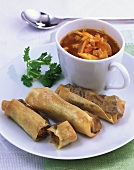 Goulash soup with mango and spring rolls with meat filling