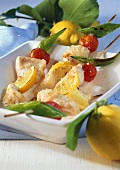 Fish kebabs with cocktail tomatoes and lemons