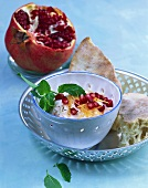 Carrot yoghurt with garlic and pomegranate seeds