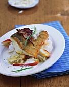 Zander fillet on apple sauerkraut with cream