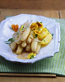 Asparagus in almond butter with spring herbs and potatoes