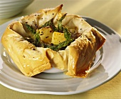 Green asparagus and diced potato in filo pastry shell