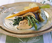 Fried trout fillet on spinach sauce with vegetables