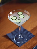 Gimlet with cucumber slices