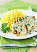Grilled chicken breast with white sauce and ribbon pasta