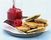 Courgette fritters with raspberry puree