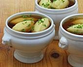 Semolina dumpling soup in soup tureens