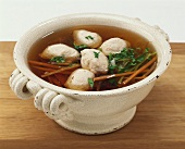 Meat broth with veal forcemeat dumplings