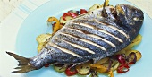Gilthead seabream on peppers and potatoes