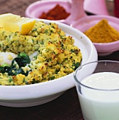 Fish and spinach gratin with couscous topping