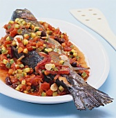Braised salmon trout with vegetables and garlic
