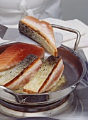 Frying fish fillets (unskinned) in a frying pan