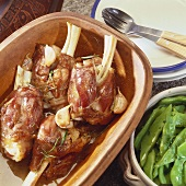 Lamb shanks with garlic in Römertopf