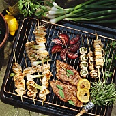 Lamb and various types of kebabs on grill rack