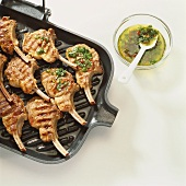 Lamb chops with herb oil on a grill pan