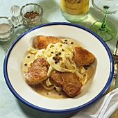Pork fillet with pepper cream sauce on fettuccine