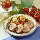 Stuffed pork roulades with tomatoes and broad ribbon pasta
