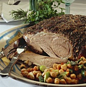 Leg of lamb with crust of herbs & seasonings and chick-peas