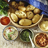 Potatoes cooked in their skins with various sauces & dips