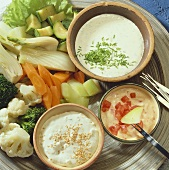 Vegetable fondue with various sauces