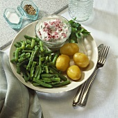 Boiled potatoes with spring quark and green beans