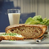 Cheese & bacon bread, one slice topped with soft cheese & chives