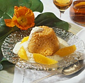 Carrot pudding with orange sauce