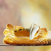 Puff pastry apricot tart with cream (cross-section)
