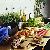 Vegetables, herbs and other foods in a kitchen