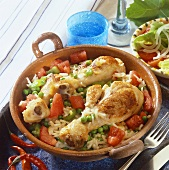 Pan-cooked chicken with rice and vegetables