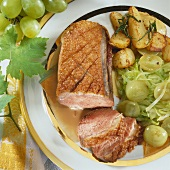 Duck breast with white cabbage & grapes and potatoes