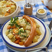 Potato and carrot stew with frankfurter