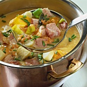 Meat and vegetables in thick pea soup