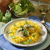 Stuffed plaice rolls on spaghetti