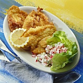 Plaice fillets in wine batter with radish salad