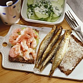 Fisherman's breakfast: shrimps and fish on black bread