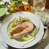 Salmon cutlet with grapes, rice and sorrel sauce