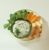 Vegetable slices and a bowl of herb quark for dipping