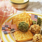 Crackers and cream cheese balls coated in nuts and herbs